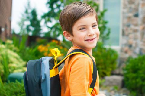 child with backpack